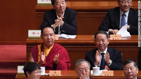 The Chinese government-selected 11th Panchen Lama Gyaincain Norbu (middle row left) applauds during a plenary session of the Chinese People's Political Consultative Conference in Beijing on March 10, 2019.