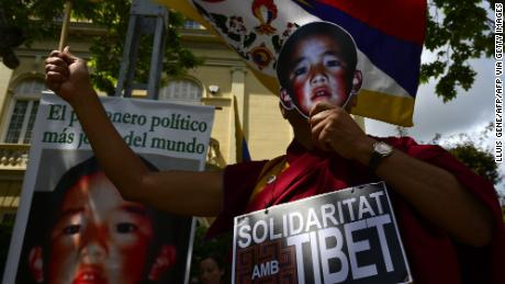 Pro-Tibetan protestors hold picures of Gendun Cheokyi Nyima (recognized by the Dalai Lama as the 11th Panchen Lama) during a demonstration outside the Chinese consulate in Barcelona on May 17, 2013.