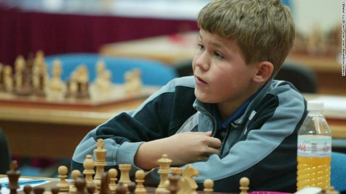 Carlsen participating in the Dubai Open chess tournament in 2004, aged 13.