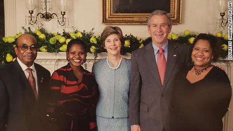 Former White House butler Wilson Roosevelt Jerman with former President George W. Bush and first lady Laura Bush.