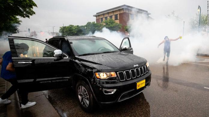 A car in Minneapolis is hit with tear gas on May 26.
