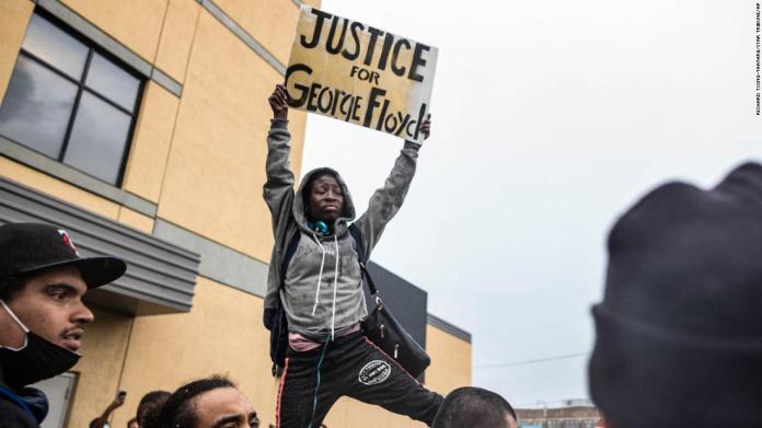 Protesters gather near the Minneapolis Police Third Precinct on May 26.