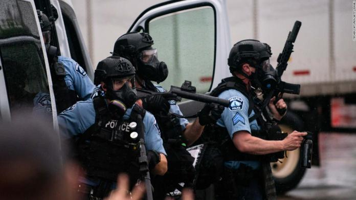 Police try to disperse crowds in Minneapolis on May 26.