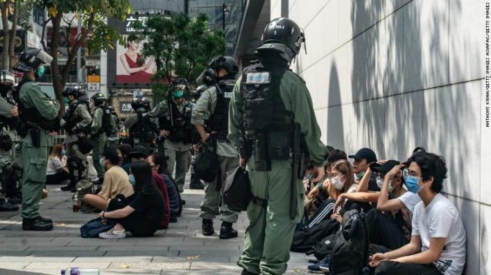 Riot police mass detain pro-democracy protesters during a rally in Causeway Bay district on May 27 in Hong Kong.