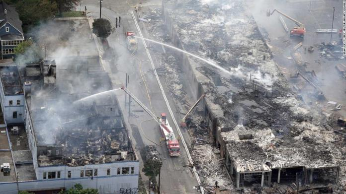 Crews work to put out fires after an apartment building under construction was burned to the ground during protests in Minneapolis on May 28.