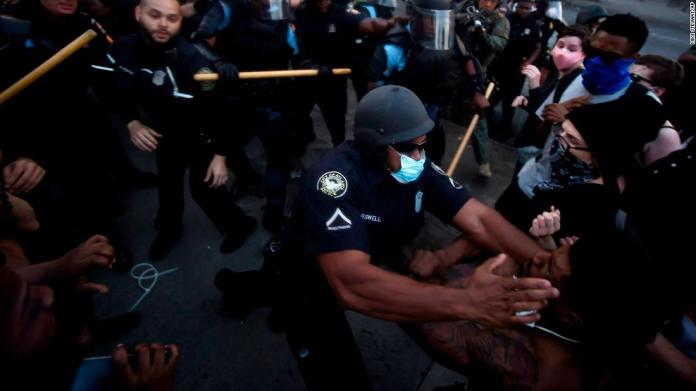 Police officers and protesters clash near the CNN Center in Atlanta on May 29.