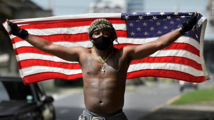 A protester holds up an American flag in New Orleans on May 29.