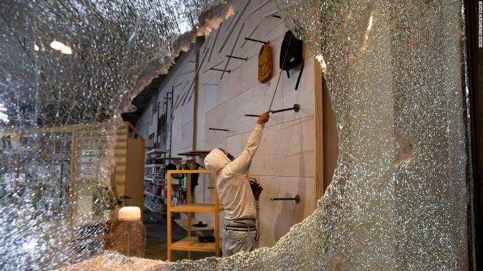 Looters ransack an Urban Outfitters store in Seattle on May 30.