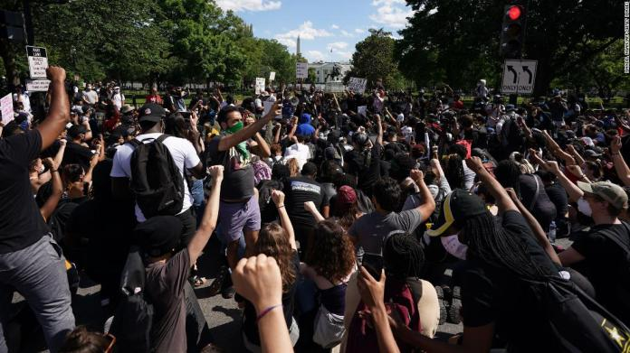 Demonstrators gather to protest near the White House on May 31.