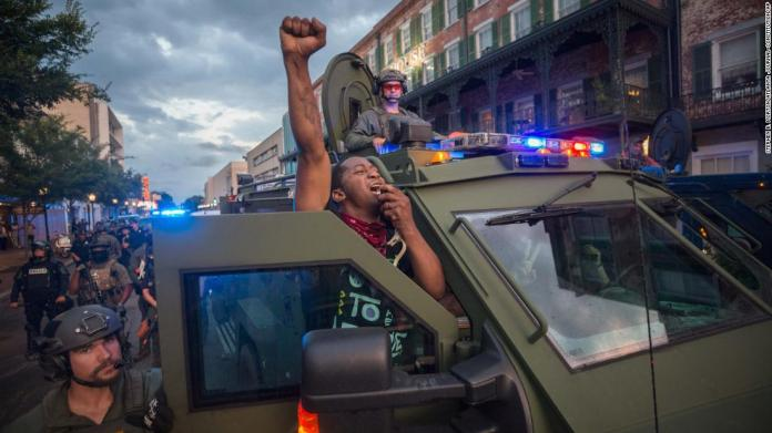 Protester Kendrick Cutkelvin uses a SWAT vehicle loudspeaker to disperse a crowd of protesters after a rally in Savannah, Georgia, on May 31.