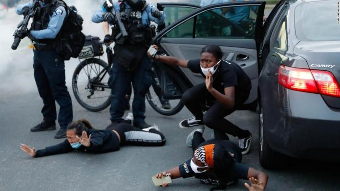 Motorists are ordered to the ground by police during a protest in Minneapolis on May 31.
