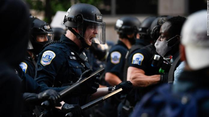 Police react to demonstrators near the White House on May 31.