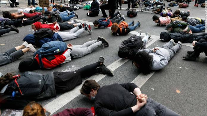 "People stage a ""die-in"" protest in Portland, Oregon, on May 31."