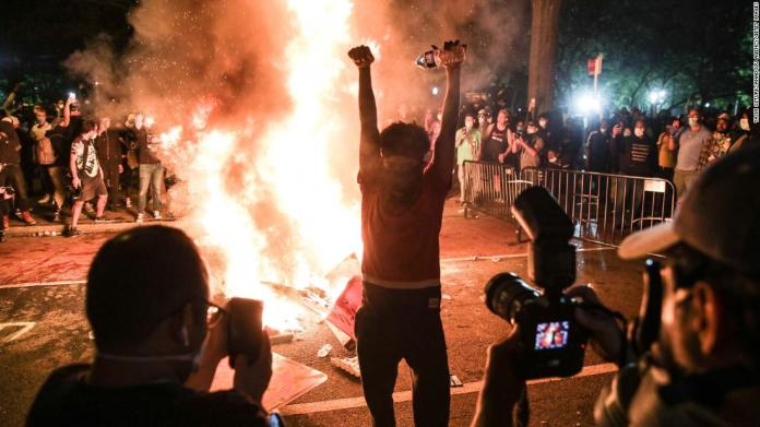 Protesters burn materials during a protest in Washington early on June 1.