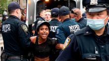"""NYPD officers arrest a protestor during a """"Black Lives Matter"""" demonstration."""