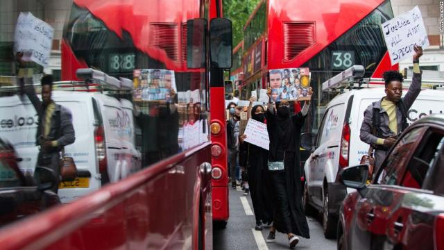Protesters moved between stopped buses and cars and the protest moved through central London.