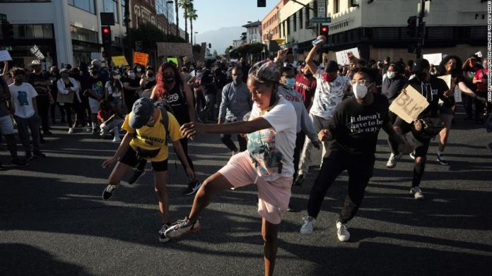 People dance in the street during a protest in Pasadena, California, on June 4.