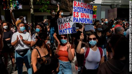 """In Madrid, a protester warns that """"Systemic racism is a pandemic."""""""