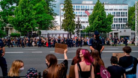 Crowds outside the US Embassy in Warsaw, Poland.