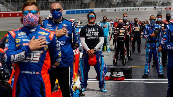 "NASCAR driver Bubba Wallace wears a shirt that reads ""I Can't Breathe - Black Lives Matter"" as the National Anthem is played before a Cup Series race at Atlanta Motor Speedway."