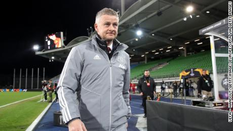 Solskjaer walks to his seat prior to the UEFA Europa League round of 16 first leg match against LASK.
