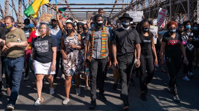 New York City Public Advocate Jumaane Williams, center, leads a march over the Brooklyn Bridge during a protest for police reform on June 8.
