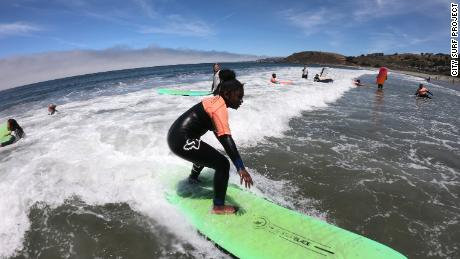 Children surfing with the City Surf Project summer camp in 2019.