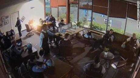 A still image from the security video, released by the Chicago mayor's office, shows officers inside a campaign office for US Rep. Bobby Rush early on June 1. CNN has reached out to the police union for comment.