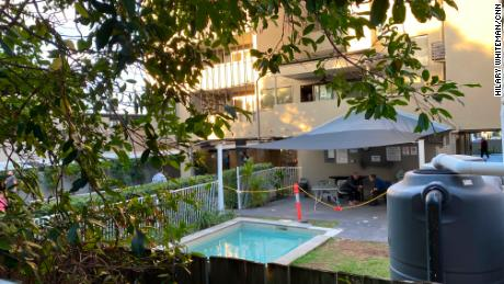 Temporary fences have been erected around the hotel, but the neighbors can see into the hotel grounds from their kitchen.