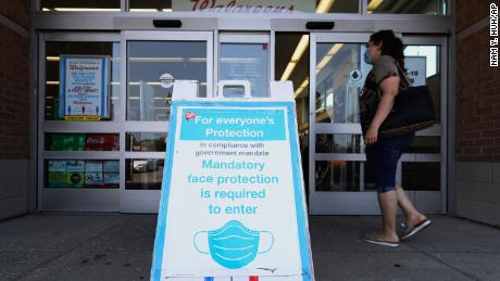 An information panel shows in front of a pharmacy Walgreens in Glenview, Illinois, on Thursday.