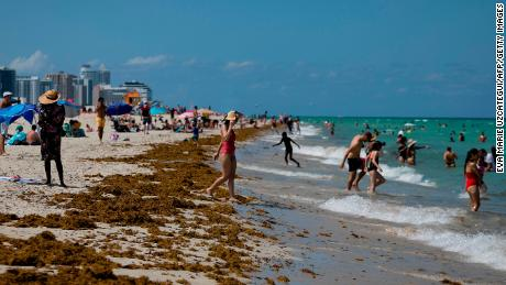 People enjoy a sunny day in Miami Beach, Florida, on June 16, 2020.