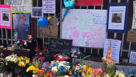 A memorial in June to Guardado near the auto body shop.