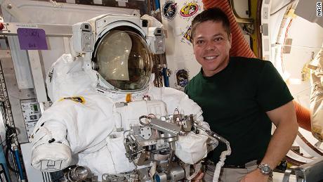 Bob Behnken poses in a spacesuit that he is preparing for two spacewalks.