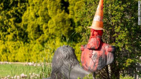"A statue in the grounds of Belgium's Royal Museum for Central Africa, featuring a bust of King Leopold II, was covered in red paint and topped with a traffic cone ""dunce's cap."""