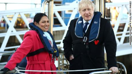 UK Home Secretary Priti Patel, left, with Prime Minister Boris Johnson on board a security vessel at the Port of Southampton on December 2, 2019.
