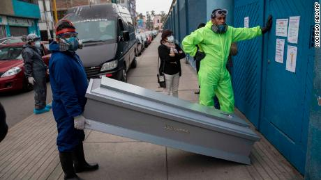 Coffins are brought to a funeral storage facility in Santiago, the capital of Chile, on June 19, 2020.