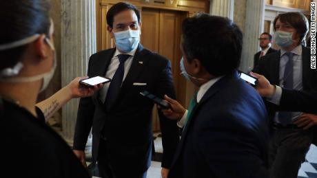 """""""Everyone should just wear a damn mask,"""" says Republican Senator Marco Rubio. He followed his own advice as he arrived for a vote in Washington, DC, on June 14."""