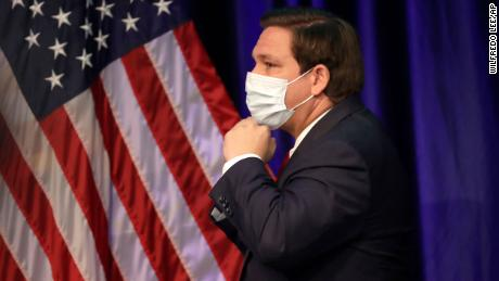 Florida governor and staunch Trump ally Ron DeSantis has resisted mandating masks for all, but he did don his own mask as he left a news conference on June 19 at Florida International University in Miami.