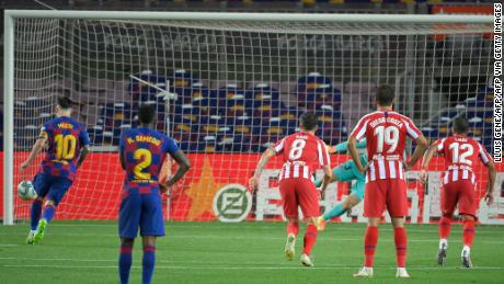 Barcelona's Lionel Messi scores a penalty to achieve 700 career goals.