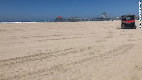 A normally crowded beach in Huntington Beach, California, is empty on July 4, 2020.