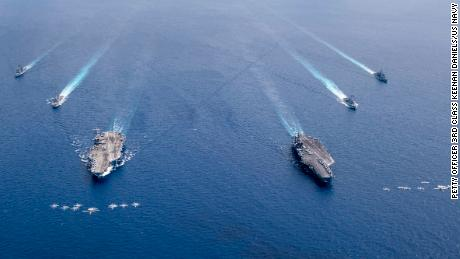 The aircraft carriers USS Nimitz and USS Ronald Reagan conduct dual-carrier operations in the South China Sea in July 2020.