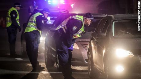 Police stop and question drivers at a checkpoint in Albury, Australia, on July 8.