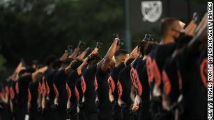 Black MLS players raise gloved fists in racial justice protest before first match