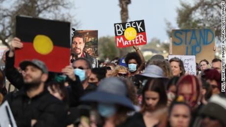 Protesters show their support during a Black Lives Matter rally in Perth, Western Australia, in June 2020.