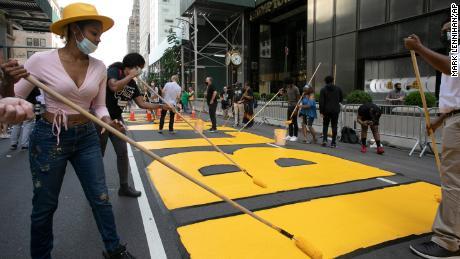 Creates Black Lives Matter murals outside Trump Tower in New York City Manhattan