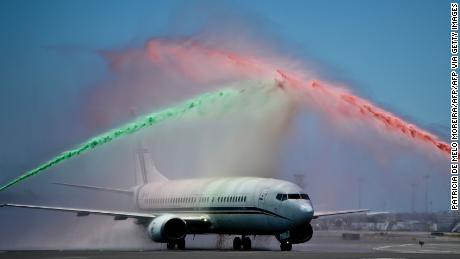Firefighters spray water in Portugal's national colors as the team return from France.