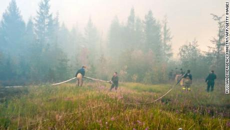 Firefighters battle to extinguish forest fires near the village of Batagay, Sakha Republic in northeastern Russia.