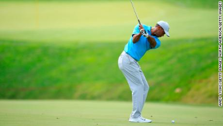 Woods plays his third shot on the 11th hole during the first round of The Memorial Tournament.