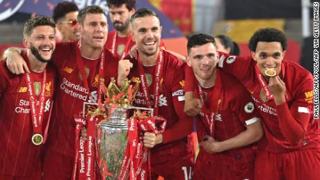 Liverpool players celebrate with the Premier League trophy.
