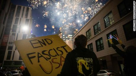 Protesters light fireworks in the middle of downtown Oakland during a protest on Saturday, July 25, 2020, in Oakland, California.